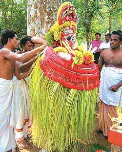 Prison warder Hari Das being transformed into a theyyam
